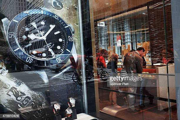 A watch advertisement is viewed along a Manhattan street on June 4 2015 in New York City As the Apple Watch and other smartwatches continue to make...