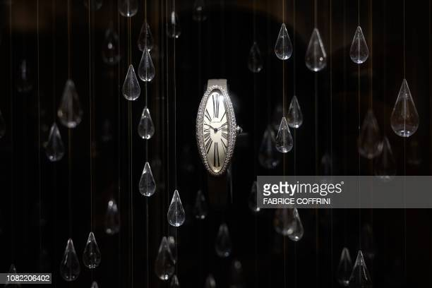 Watch by Cartier is displayed at the French luxury goods conglomerate company on the opening day of the 28h International Fine Watchmaking Exhibition...