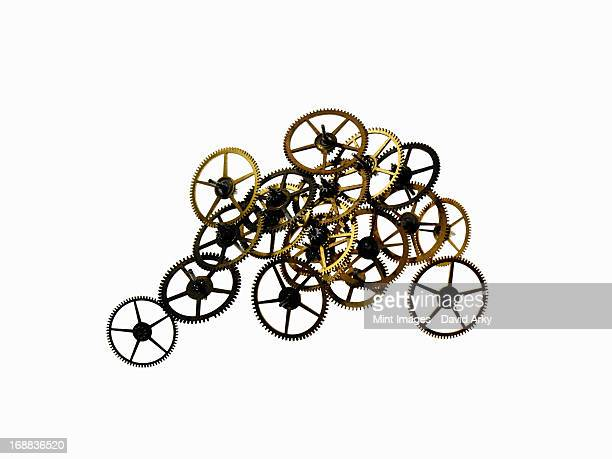 Watch gears, small precision made cog wheels with spokes and fine teeth or notches around the edge. Arranged in a neat row.