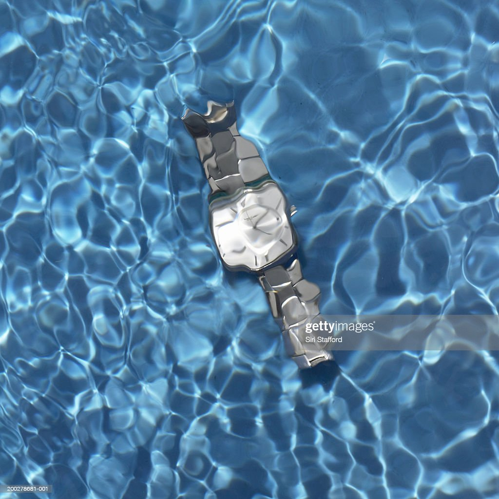 Watch in swimming pool : Stock Photo