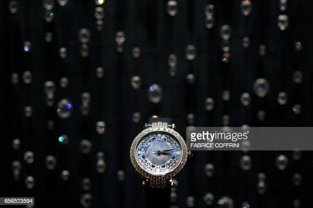 A watch is displayed at the stand of American luxury jeweler and producer of Swiss timepieces Harry Winston during the press day on the eve of the...