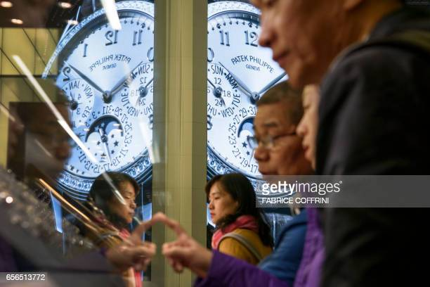 A watch is displayed on a giant screen at the stand of Swiss watchmaker Patek Philippe during the press day on the eve of the opening of the...