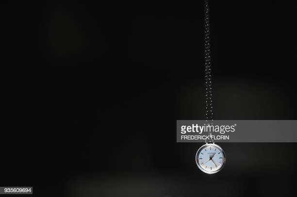 A watch is pictured in the stand of Swiss watchmaker Citizen during the press day on March 21 on the eve of the opening of the Baselworld watch and...