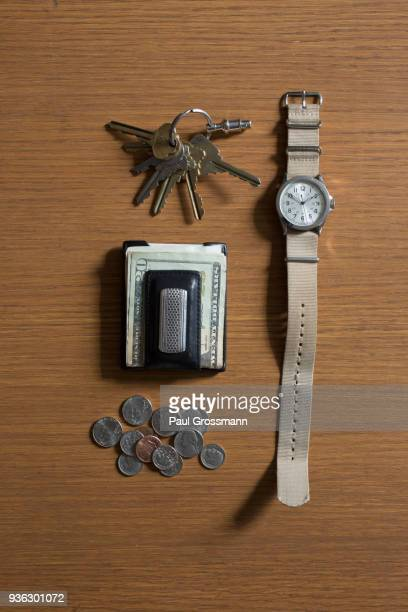 watch, keys and money on table - キーホルダー ストックフォトと画像