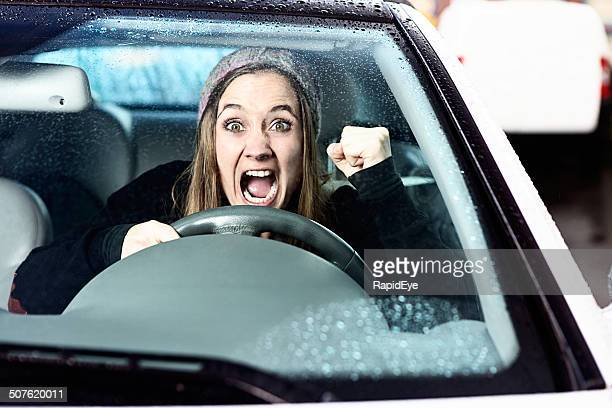 Watch out! Enraged woman driver shakes her fist