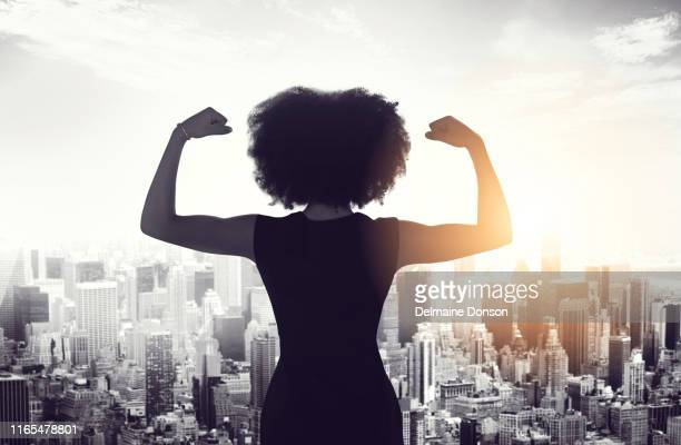 watch out world! this woman is on her way - flexing muscles stock pictures, royalty-free photos & images
