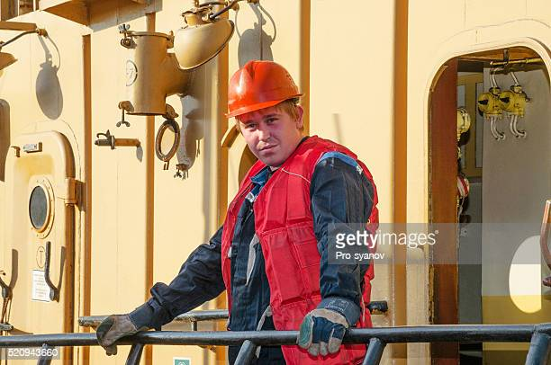 Watch sailor on the deck of the tug boat