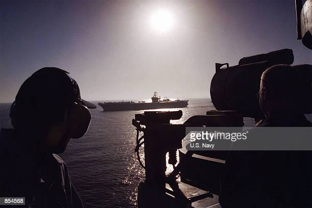 Watch standers onboard USS Theodore Roosevelt observe USS Carl Vinson the ship pulls alongside her sister nuclear aircraft carrier for a Battle Force...