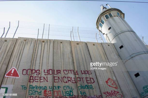 A watch tower and graffiti seen on the West Bank Separation Wall The Israeli Separation Wall is a dividing barrier that separates the West Bank from...