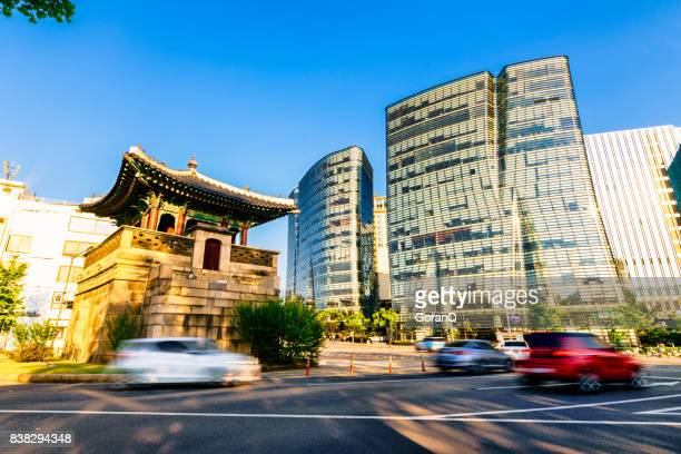 watch tower on street traffic with modern buildinge in south korea - south korea stock pictures, royalty-free photos & images