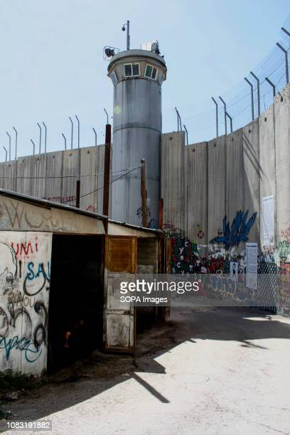 A watch tower seen alongside the Israeli West Bank The Israeli Separation Wall is a dividing barrier that separates the West Bank from Israel
