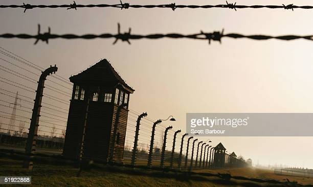 Watch towers surrounded by mulitiple high voltage fences December 10 2004 at Auschwitz II Birkenau which was built in March 1942 in the village of...