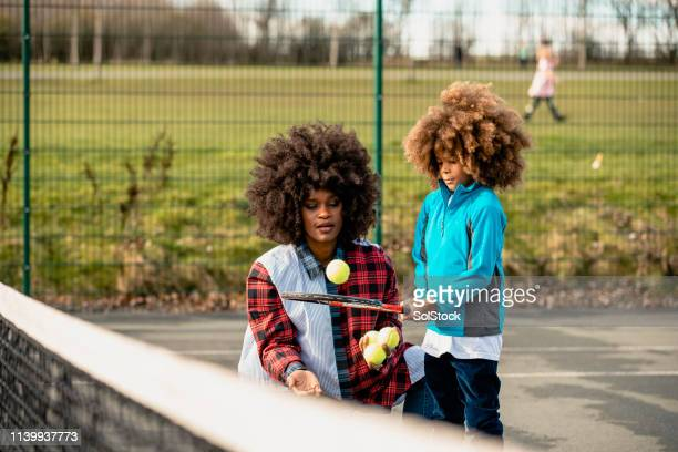 watch what i can do mum! - tennis stock pictures, royalty-free photos & images
