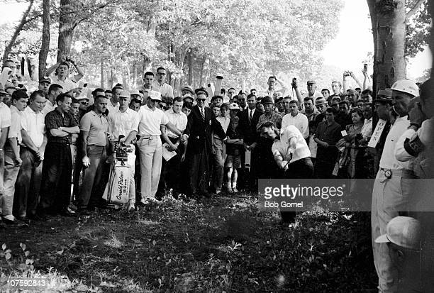 Watched by a crowd of spectators, American golfer Arnold Palmer swings during the US Open golf championship. Brookline, Massachusetts, June 1963.