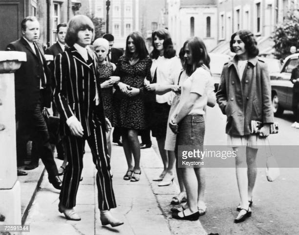 Watched by a group of fans Rolling Stones guitarist Brian Jones leaves West London Magistrate's Court after a hearing on drugs charges 2nd June 1967