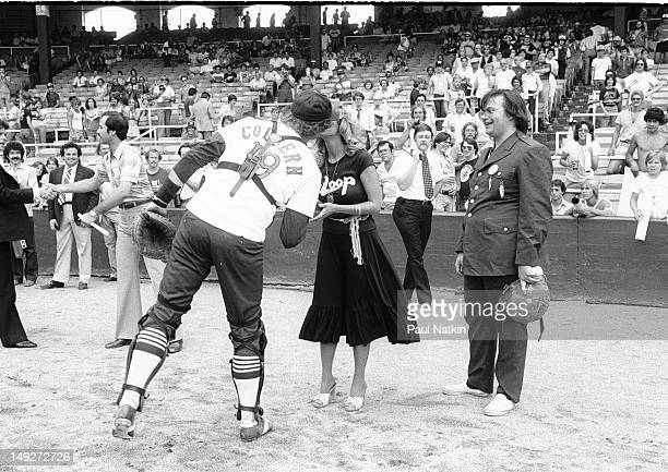 Watched by American disc jockey Steve Dahl Chicago White Sox catcher Mike Colbern kisses model Lorelei Shark during an antidisco promotion at...
