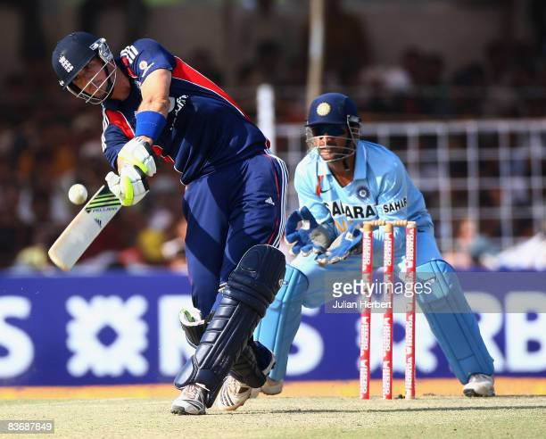 Watched by MS Dhoni of Indaia Kevin Pietersen hits out at the bowling during the 1st One Day International between India and England played at The...