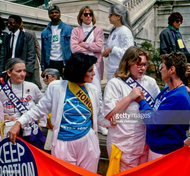 Watched by her lawyer Gloria Allred activist Norma McCorvey talks with an unidentified event 'facilitator' on the steps of the US Capitol during the...