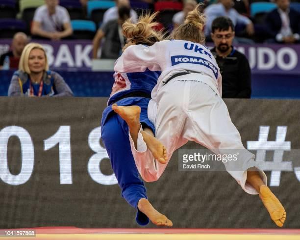 Watched by her mother Svetlana Daria Bilodid of the Ukraine throws Distria Krasniqi of Kosovo for a wazari to win their u48kg elimination contest...