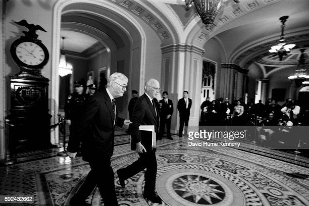 Watched by journalists Democratic senators Patrick Moynihan and Patrick Leahy talks with reporters the hallways of the US Capitol Building during the...