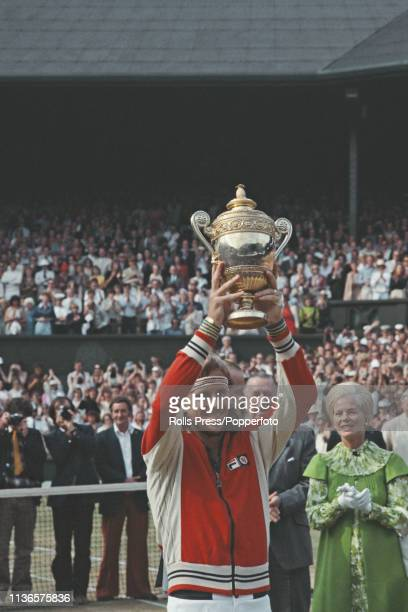 Watched by Katharine, Duchess of Kent, Swedish tennis player Bjorn Borg holds up the Gentlemen's Singles Trophy after defeating Roscoe Tanner to win...