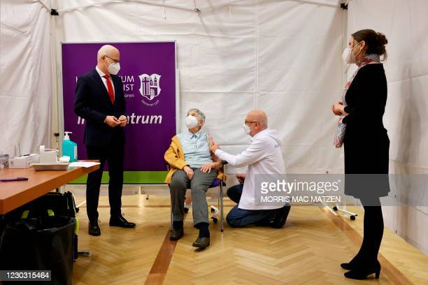 Watched by Mayor Peter Tschentscher and senator for social affairs Melanie Leonhard , 84 year old Karin Sievers becomes the first to be inoculated...