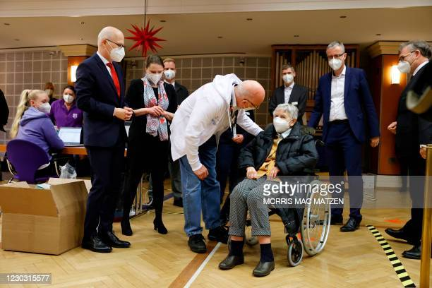 Watched by Mayor Peter Tschentscher and senator for social affairs Melanie Leonhard , 84 year old Karin Sievers arrives to be inoculated with a dose...