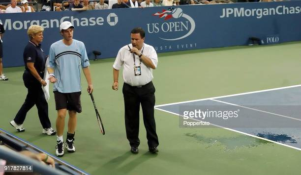 Watched by referee James Morrisey Andy Murray of Great Britain had just vomitted on court for the second time during his first round match against...