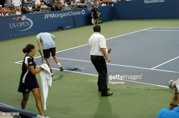 Watched by referee James Morrisey Andy Murray of Great Britain vomits on court for the second time during his first round match against Andrei Pavel...