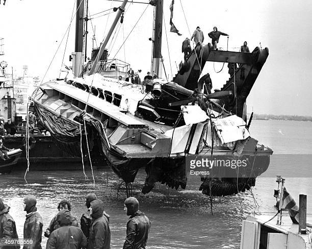 Watched by Royal Navy divers the battered SRN6 hovercraft is raised from the Portsmouth seabed in England March 8 1972