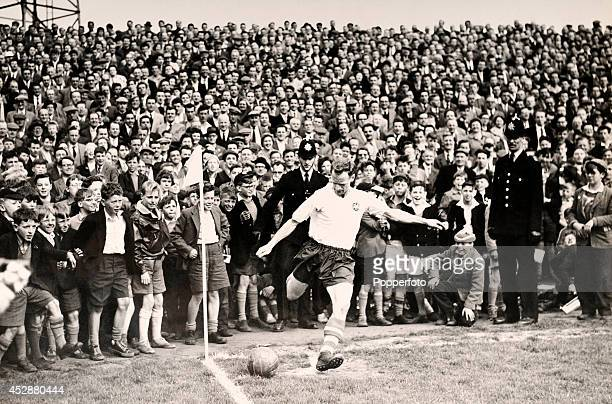 Watched by schoolboys on the touchline, Tom Finney of Preston North End takes his last corner kick during his last game at Deepdale Stadium in...
