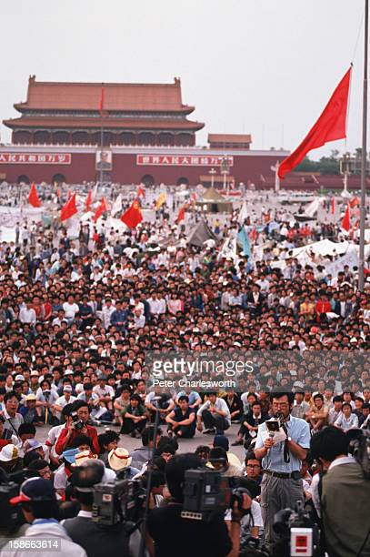 Watched by thousands of protestors one of the prodemocracy movement leaders gives a press conference through a megaphone in Tiananmen Square...