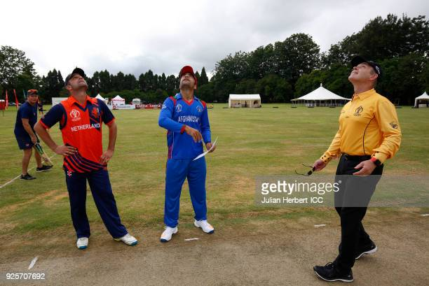 Watched by umpire Simon Fry Rashid Khan Arman of Afghanistan and Peter Borren of The Netherlands take part in the coin toss before The ICC Cricket...