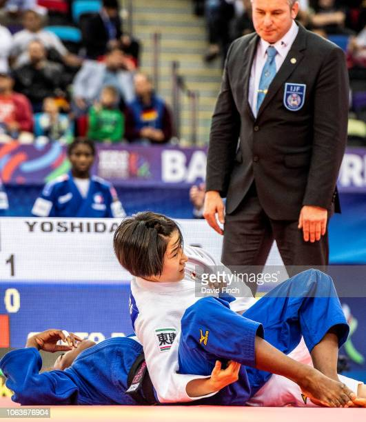 Watched closely by the referee Tsukasa Yoshida of Japan holds Priscilla Gneto of France for an ippon to take Japan 20 in the team final on day eight...