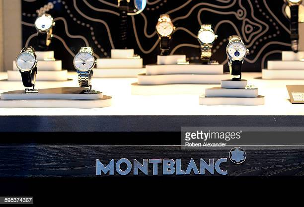 Watches are featured in a window display at the Montblanc store on Via Tornabuoni in Florence Italy Montblanc boutiques sell highend timepieces...