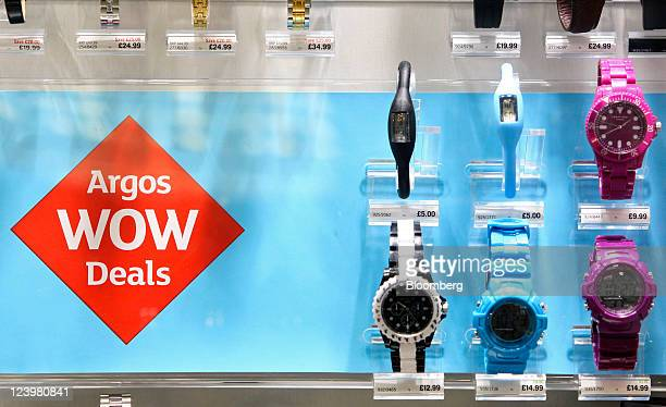 Watches sit on display inside an Argos store operated by Home Retail Group Plc in Enfield UK on Wednesday Sept 7 2011 Home Retail Group Plc owner of...