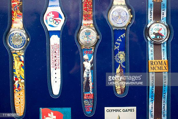 Watches with Olympic Games logo are displayed at VV auction room in Paris on February 2 2011 300 pieces medals torches posters photographs etc will...