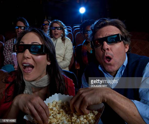 watching a 3d movie - redoubtable film stock photos and pictures
