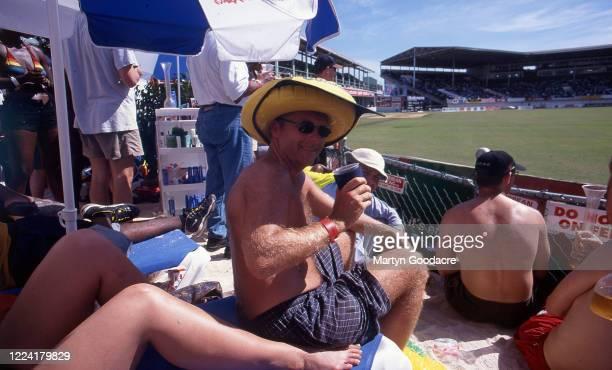 Watching a cricket match at Sabina Park Cricket Ground, Jamaica, 1998.