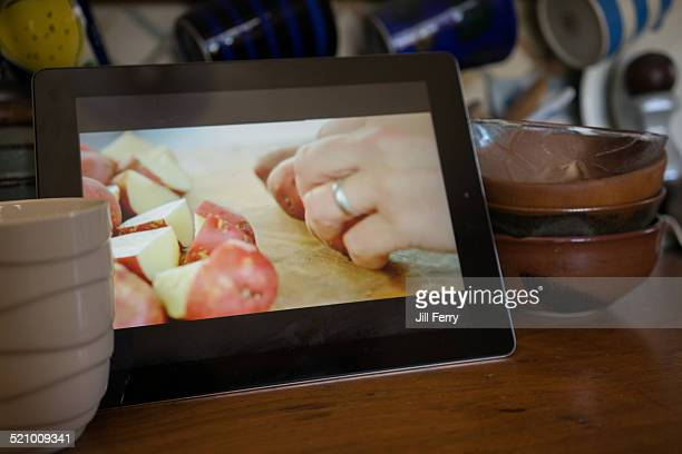 Watching a Jamie Oliver cooking episode in the kitchen on an iPad