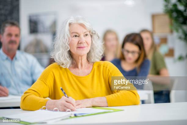 watching a lecture attentively - old university stock pictures, royalty-free photos & images