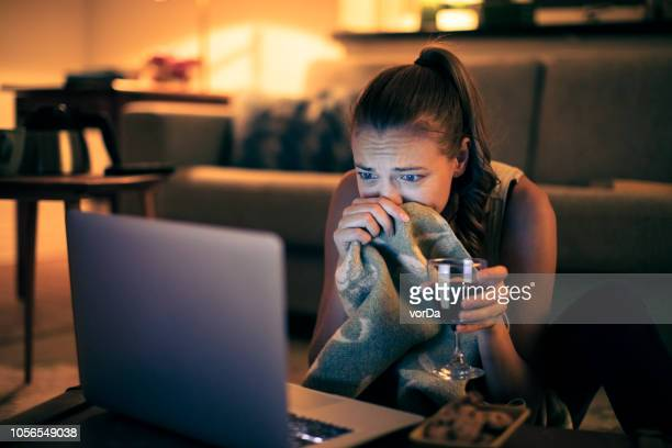 watching a movie - scary movie stock photos and pictures