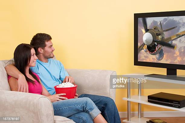watching a movie - dvd player stock photos and pictures