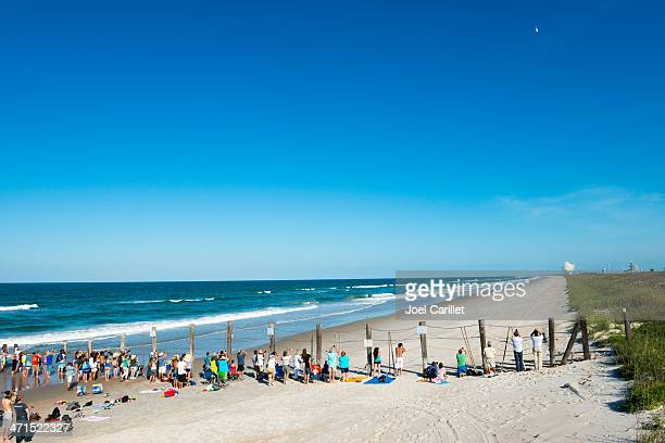 watching a rocket launch at cape canaveral - titusville florida stock pictures, royalty-free photos & images