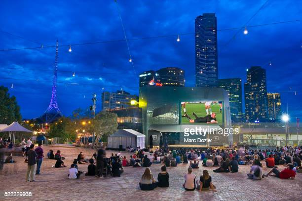 Watching a rugby match at Federation Square in Melbourne