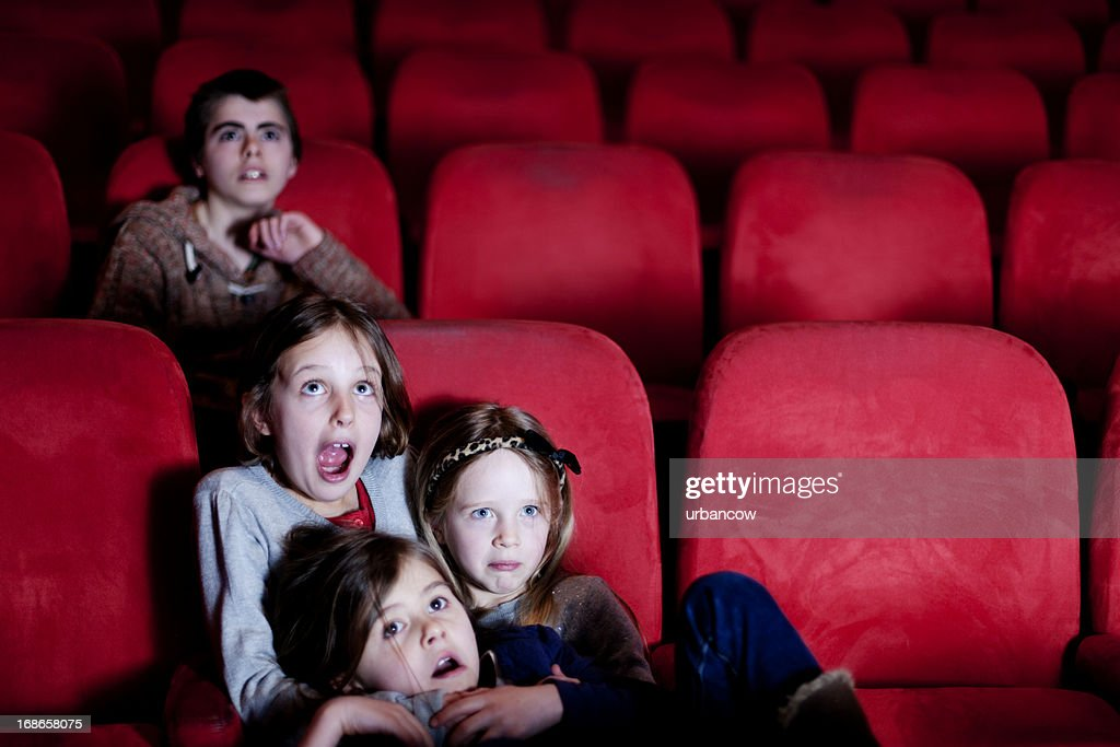Watching a scary movie : Stock Photo