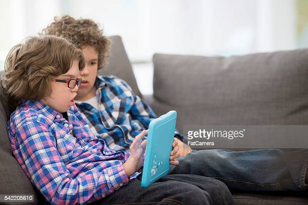watching a video on a digital tablet - assistive technology stock photos and pictures