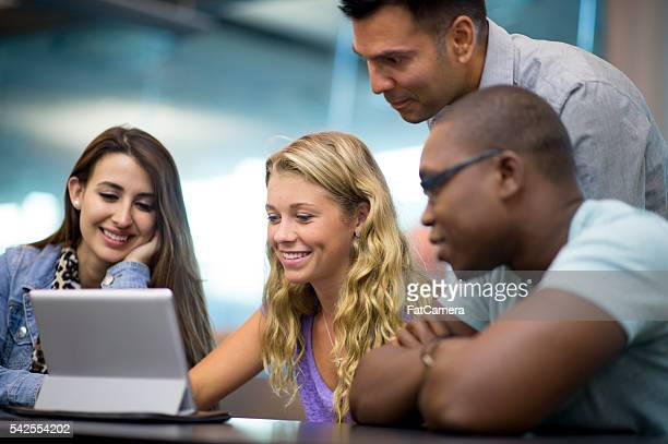 watching a video on a digital tablet - community college stock pictures, royalty-free photos & images