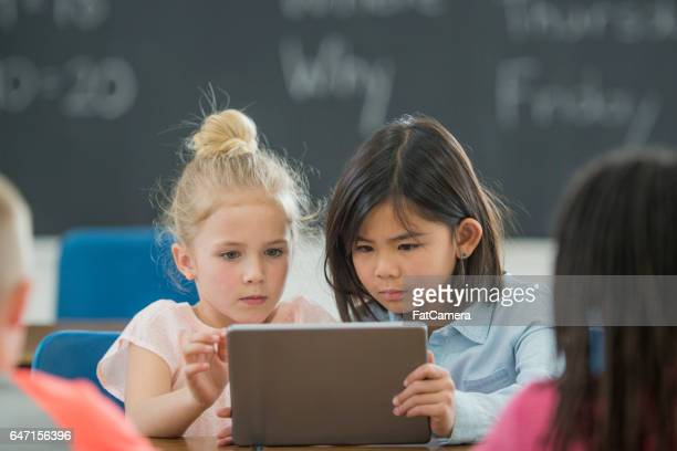 watching a video on a digital tablet - digital native stock photos and pictures