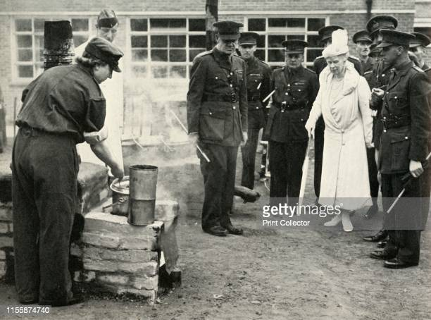 Watching ATS girls at work with a field kitchen during one of her visits to the Army School of Cookery at Aldershot' circa 1941 Queen Mary of Teck is...